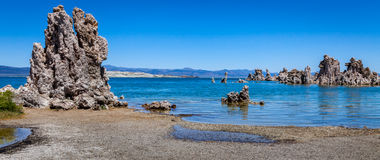 Mono Lake. Calcium formation at Mono Lake in the middle of the water with the mountain on background Stock Image