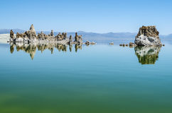Mono Lake. The natural limestone tufa tower formations at Mono Lake and his reflex in lake Royalty Free Stock Image