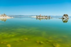 Mono Lake. The natural limestone tufa tower formations at Mono Lake and his reflex in lake Stock Photos