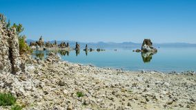 Mono Lake. The natural limestone tufa tower formations at Mono Lake and his reflex in lake Stock Photo