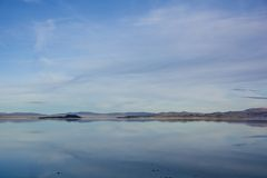 Mono Lake Reflection. The reflection of the land and sky portraying on the water, at the Mono Lake, California, USA Stock Photo