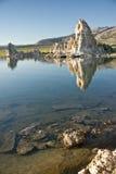 Mono Lake Reflections. Tufa rock formations reflect in Mono Lake stock images