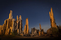 Mono Lake Tufa Formations at Night. Light painted Tufa rock formations at Mono Lake, California at night.  Starry skies with dramatic light on ancient rock Royalty Free Stock Photo