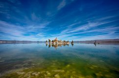 Mono Lake with tufa tower reflection in the water in California stock image