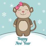Mono lindo debajo de la nieve Símbolo de 2016 en el calendario chino Fotos de archivo libres de regalías