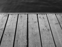 Mono shot of the edge of a wooden jetty stock image