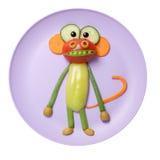 Mono vegetal divertido hecho en la placa rosada Imagen de archivo libre de regalías