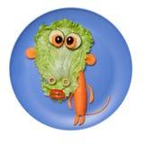 Mono vegetal sorprendido hecho en la placa azul Fotografía de archivo libre de regalías