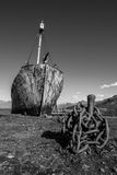 Mono whaler with harpoon beside rusty chain stock images