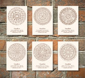 Monochrom mandala in black frame on the brick wall Royalty Free Stock Images