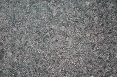 Monochromatic texture of granite surface. Detailed photo of the treated glossy granite stone, which is used as tiles for walls and floors Royalty Free Stock Image