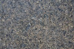 Monochromatic texture of granite surface. Detailed photo of the treated glossy granite stone, which is used as tiles for walls and floors Royalty Free Stock Images