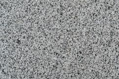 Monochromatic texture of granite surface. Detailed photo of the treated glossy granite stone, which is used as tiles for walls and floors Stock Photos