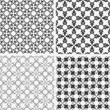 Monochrome abstract floral seamless patterns. Vector set Royalty Free Stock Images