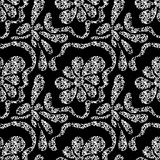 Monochrome abstract flowers on a black background seamless pattern Royalty Free Stock Photos