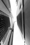 Midtown Manhattan Skyscrapers Low Angle Monochrome. Monochrome abstractization of skyscrapers seen from directly below, with a no standing anytime sign Royalty Free Stock Photos