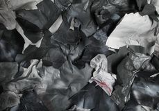 Monochrome background of torn pieces of black and white paper Stock Image