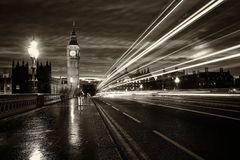 Monochrome Big Ben London. Monochrome Big Ben and London at night with the lights of the cars passing by after rain, London and England Royalty Free Stock Photography