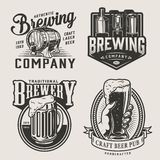 Monochrome brewery vintage emblems. With brewing machine wooden cask mug of alcohol drink and male hand holding beer glass isolated vector illustration royalty free illustration