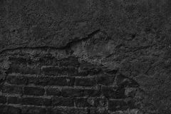 Monochrome Brick wall stone background - texture for continuous rocks.  royalty free stock images
