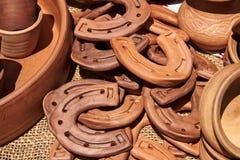 Monochrome ceramic decorative horseshoes handmade. In natural sunlight Stock Photos