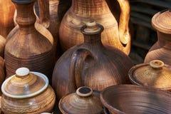 Monochrome ceramic handmade bottles and jugs. Under natural sunlight Stock Photos