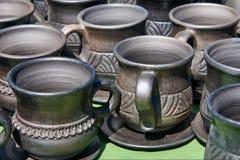 Monochrome ceramic mugs and saucers handmade Stock Photography