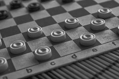 Monochrome Checkers in checkerboard ready for playing. Game concept. Board game. Hobby. checkers on the playing field for a game.  royalty free stock photography