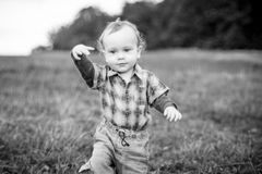 Monochrome child portrait, kid playing outdoors Royalty Free Stock Photo