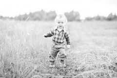 Cute kid in nature black and white Royalty Free Stock Image