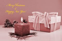 Monochrome Christmas background, vintage greeting card with burning candle Royalty Free Stock Image