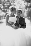 Monochrome closeup portrait of happy bride and groom kissing und Royalty Free Stock Image