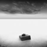 Monochrome. Daytime long exposure seascape with object in the sea. The photo taken in black and white. Black sea, Odessa, Ukraine Royalty Free Stock Images