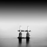 Monochrome. Daytime long exposure seascape with object in the sea. The photo taken in black and white. Black sea, Odessa, Ukraine Royalty Free Stock Photography