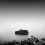 Monochrome. Daytime long exposure seascape with object in the sea. The photo taken in black and white. Black sea, Odessa, Ukraine Stock Photo