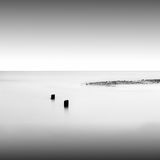 Monochrome. Daytime long exposure seascape with object in the sea. The photo taken in black and white. Black sea, Odessa, Ukraine Stock Image