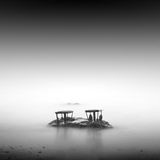 Monochrome. Daytime long exposure seascape with object in the sea. The photo taken in black and white. Black sea, Odessa, Ukraine Stock Photography