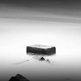 Monochrome. Daytime long exposure seascape with object in the sea. The photo taken in black and white. Black sea, Odessa, Ukraine Royalty Free Stock Image