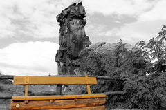 Monochrome Devils` Wall Teufelsmauer with colored wooden bench. Colored wooden bench with monochrome Devils` Wall near Weddersleben in Harz Mountains Germany Stock Photos