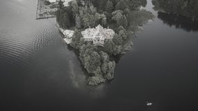 Monochrome photography of an old abandoned house. Monochrome drone photography of an old abandoned house on a lake shore stock photos