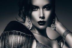 Monochrome elegant woman in accessories of stones Stock Photo