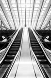 Monochrome escalator in futuristic interior Stock Image