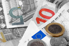 Monochrome euro banknotes, coins, calculator Royalty Free Stock Images