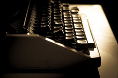 Monochrome filtered Typewriter on table. Royalty Free Stock Image