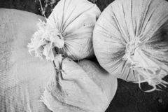 Monochrome folded pile bright agricultural bag on top stock images