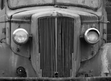 Monochrome front view of an old abandoned rusty 1940s truck. A monochrome front view of an old abandoned rusty 1940s truck royalty free stock photography