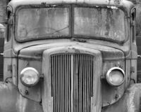 Monochrome front view of an old abandoned rusty 1940s truck. A monochrome front view of an old abandoned rusty 1940s truck stock photos