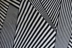 Monochrome geometric pattern on fabric. From above stock photos