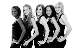 Monochrome Girls. Five beautiful young women in black on white Stock Photo