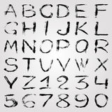 Monochrome graffiti alphabet and numbers on a light background vector illustration Stock Images